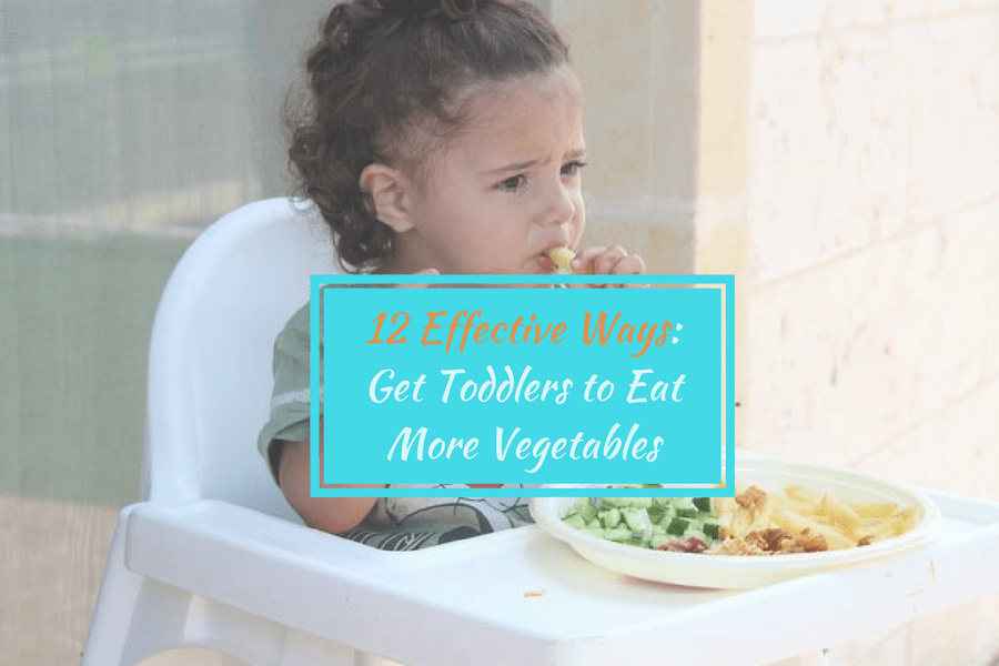 a toddler is eating vegetable with hand while seating in baby seat