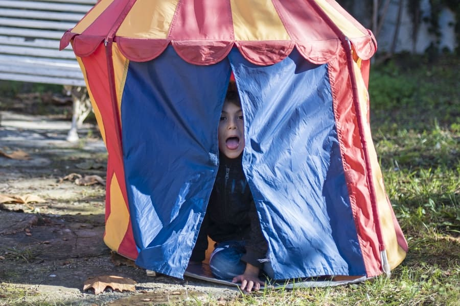 kid in tent
