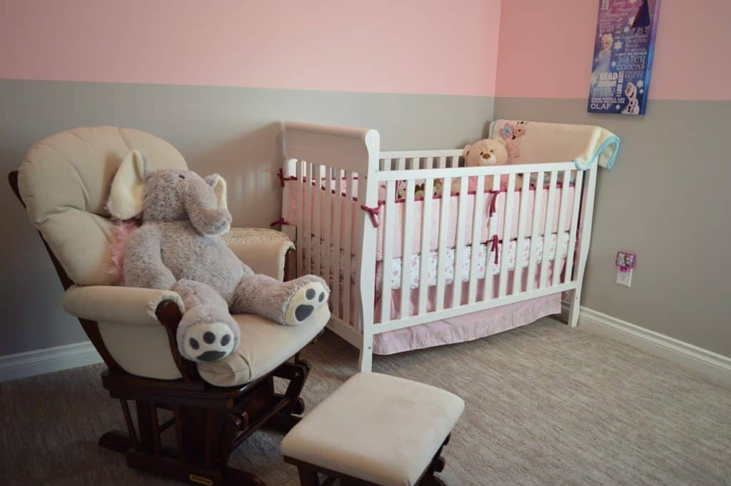 crib and nursing chair