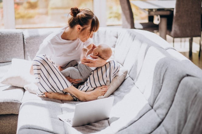 mother with kid working from home